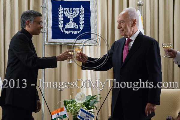 President of the State of Israel, Shimon Peres (R) and Jaideep Sarkar (L), newly appointed Indian Ambassador to Israel, raise a toast to the Ambassador's success. Jerusalem, Israel. 4-Dec-2012.<br /> <br /> Jaideep Sarkar, newly appointed Indian Ambassador to Israel, presents his Letter of Credence to the President of the State of Israel, Shimon Peres, in a formal ceremony at the President's Residence.