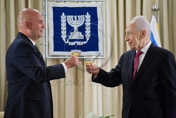 President of the State of Israel, Shimon Peres (R) and Pjer Simunovic (L), newly appointed Croatian Ambassador to Israel, toast the Ambassador's success. Jerusalem, Israel. 4-Dec-2012.<br /> <br /> Pjer Simunovic, newly appointed Croatian Ambassador to Israel, presents his Letter of Credence to the President of the State of Israel, Shimon Peres, in a formal ceremony at the President's Residence.