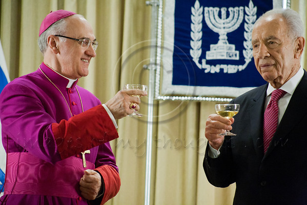 President of the State of Israel, Shimon Peres and Archbishop Giuseppe Lazzarotto, newly appointed Vatican Ambassador to Israel, raise a toast to the Ambassador's success. Jerusalem, Israel. 4-Dec-2012.<br /> <br /> Archbishop Giuseppe Lazzarotto, newly appointed Vatican Ambassador to Israel, presents his Letter of Credence to the President of the State of Israel, Shimon Peres, in a formal ceremony at the President's Residence. Jerusalem, Israel. 4-Dec-2012.