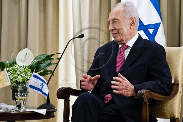 President of the State of Israel, Shimon Peres, at an introductory meeting with Archbishop Giuseppe Lazzarotto, newly appointed Vatican Ambassador to Israel. Jerusalem, Israel. 4-Dec-2012.<br /> <br /> Archbishop Giuseppe Lazzarotto, newly appointed Vatican Ambassador to Israel, presents his Letter of Credence to the President of the State of Israel, Shimon Peres, in a formal ceremony at the President's Residence. Jerusalem, Israel. 4-Dec-2012.