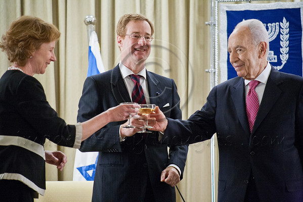 President of the State of Israel, Shimon Peres (R), Count John Cornet d'Elzius (C), Belgian Ambassador to Israel, and the Ambassador's wife (L) raise a toast to the Ambassador's success. Jerusalem, Israel. 4-Dec-2012.<br /> <br /> Count John Cornet d'Elzius, newly appointed Belgian Ambassador to Israel, presents his Letter of Credence to the President of the State of Israel, Shimon Peres, in a formal ceremony at the President's Residence. Jerusalem, Israel. 4-Dec-2012.