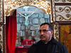 "Father Nadim Shakur presents the Mi'ilya Church of the Annunciation interior showing the ""Templon"", a decorated covered screen with icons and paintings,  which separates  the hall and the sanctuary behind it. Mi'ilya, Israel. 11-Dec-2012. <br /> <br /> Mi'ilya, an Arab village in the Western Galilee, has a population of 3,100 Melkite Christians belonging to the Greek Catholic Church tracing their history to 1st century Christians of Antioch, Turkey, where Christianity was introduced by St. Peter."