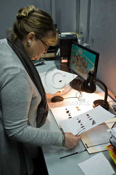 Israel Museum Antiquities Authority labs technician prepares original fragments of the Dead Sea Scrolls for advanced spectral scanning with both color imaging within the visible light spectrum and infra-red to reveal writing in damaged areas. Jerusalem, Israel. 18-Dec-2012.<br />  <br /> The Israel Antiquities Authority and Google Israel launch a website featuring photographs of the Dead Sea Scrolls, the most recognized, holy, biblical manuscripts written 2,000 years ago, including the Ten Commandments and Chapter 1 of Genesis.