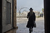 A religious Jewish man in traditional ultra-Orthodox clothes enters the Old City through the Jaffa Gate on the morning of the Winter Solstice, and what some expect to be, the 'end of the world'. Jerusalem, Israel. 21-Dec-2012.<br /> <br /> A cold, windy and rainy Winter Solstice morning at the Jaffa Gate as locals and tourists seek refuge from the rain rather than Armageddon at end of the Mayan Calendar.
