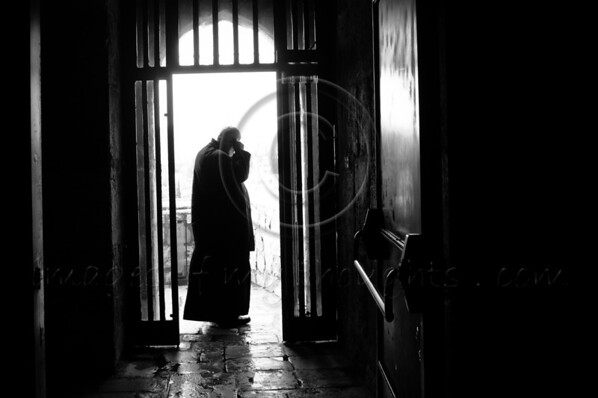 A priest uses a cell phone at the end of a dark hallway in the King David Tower Museum on the morning of the Winter Solstice, and what some expect to be, the 'end of the world'. Jerusalem, Israel. 21-Dec-2012.<br /> <br /> A cold, windy and rainy Winter Solstice morning at the Jaffa Gate as locals and tourists seek refuge from the rain rather than Armageddon at end of the Mayan Calendar.