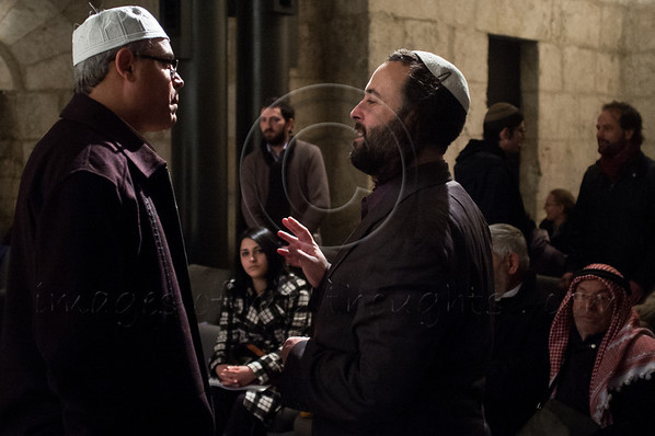 Jewish Eliyahu McLean (R), Director of the Jerusalem Peacemakers, meets Muslim Sheik Hassan of Nazareth (L), at an interfaith prayer of unity at the King David Tower Museum, where organizers are proud to have assembled all the 'children of Abraham'. Jerusalem, Israel. 21-Dec-2012.<br /> <br /> As the world speculates the end of the world, UNIFY congregates hundreds of thousands around the world at major sacred sites in Jerusalem, the Giza Pyramids, Stonehenge, the Taj Mahal, and more, simultaneously praying for the harmony of the planet.