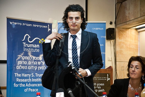 Maikel Nabil Sanad enters a press conference at the Hebrew University's Mount Scopus Truman Institute. Following the press conference Nabil Sanad spoke to the Israeli public at an open lecture. Jerusalem, Israel. 23-Dec-2012.<br /> <br /> Maikel Nabil Sanad, Egyptian human rights dissident, Tahrir Square democracy blogger, and former 302-day political prisoner, meets members of the press at the Hebrew University while beginning a peace-building mission in Israel organized by UN Watch.