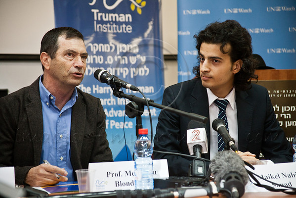 Professor Menahem  Blondheim (L), Director of the Harry S. Truman Research Institute for the Advancement of Peace, welcomes Maikel Nabil Sanad (R) to the Hebrew University. Jerusalem, Israel. 23-Dec-2012.<br /> <br /> Maikel Nabil Sanad, Egyptian human rights dissident, Tahrir Square democracy blogger, and former 302-day political prisoner, meets members of the press at the Hebrew University while beginning a peace-building mission in Israel organized by UN Watch.