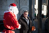 Issa, in a Santa Claus costume, shakes the hand of a religious Jewish man, at a Christmas tree distribution site at the Jaffa Gate. Jerusalem, Israel. 23-Dec-2012.<br /> <br /> The Keren Kayemeth LeIsrael - Jewish National Fund, and the Jerusalem Municipality, assisted by Issa dressed as Santa Claus, distribute specially grown Arizona Cypress trees as Christmas trees to the Christian population at the Jaffa Gate.