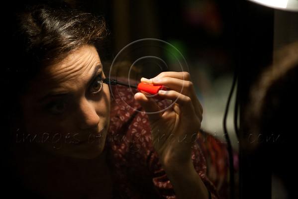 An Israeli Opera Carmen performer applies mascara, backstage, before full dress rehearsal. Massada, Israel. 6-June-2012.