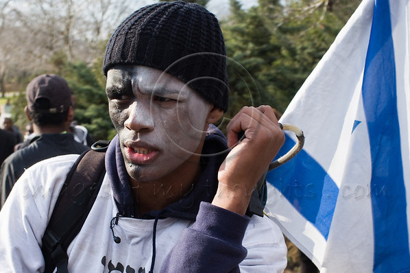 Mulet Hararo, 26, an IDF officer and physical education student, who just finished a 70Km 3-day trek to Jerusalem from his home in Kiryat Malachi is joined by thousands of Ethiopians protesting discrimination. Jerusalem, Israel. 18th January 2012.