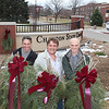 Chadron State College Arboretum Volunteers Jane Darnell, Roger Mays and Dewayne Gimeson display three of the holiday swags that the group constructed during its work day Nov. 10. In addition to adorning the campus, the volunteers donated swags to Prairie Pines Lodge, Crest View Care Center and the Chadron Public Library. (Photo by Justin Haag)