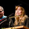 """Jade McConkey delivers the opening """"moment of reflection for Chadron State College's ceremony for master's degree recipients. McConkey was awarded a Master of Education degree. (Photo by Tiffany Valandra)"""