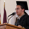 """Joshua Rose delivers the closing """"moment of reflection"""" during Chadron State College's commencement ceremony for bachelor's degree recipients Dec. 14. Rose was awarded a Bachelor of Arts degree. (Photo by Tiffany Valandra)"""