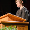 """Lauren Bauer delivers the opening """"moment of reflection"""" for Chadron State College's ceremony for master's degree recipients. Bauer was awarded a Master of Education degree. (Photo by Tiffany Valandra/Chadron State College)"""