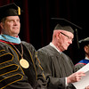 """Dr. Randy Rhine, Gary Bieganski, and Dr. Charles Snare listen to the opening """"moment of reflection."""" (Photo by Tiffany Valandra/Chadron State College)"""