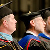 Dr. Randy Rhine, Dr. Charles Snare, and Dr. Charles Butterfield listen to the commencement greeting. (Photo by Tiffany Valandra/Chadron State College)