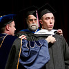 Bridger Chytka is hooded by Dr. Joel Hyer and Dr. Charles Butterfield. Chytka was awarded a Master of Arts in Education on May 4. (Photo by Tiffany Valandra/Chadron State College)