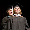 Jana Sickler is hooded by Dr. Margaret Crouse. Sickler was awarded a Master of Arts in Education on May 4. (Photo by Tiffany Valandra/Chadron State College)