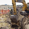 Fuller Construction crews dig a trench Thursday, March 14 at the corner of Tenth and Cedar in Chadron for a sewer line leading to the new Chadron State College Rangeland Complex to be located southwest of the city water tower in the upper left.