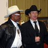 Charlie Sampson, 1982 world champion profession bull rider joins Chadron State College rodeo coach Dustin Luper at the annual Black Tie Calf Fry fundraiser on Friday, Feb. 22, 2013. Luper said 175 people attended and $9,132 was raised from the silent and live auctions.