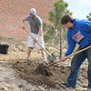 Chadron State College senior Clayton Osborn, a biology major, and sophomore Connor Bila majoring in business management assist CSC horticulturist Lucinda Mays with a major planting project on the west side of Burkhiser.