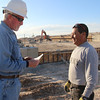 Craig Hadan, Superintendent with general contractor Sampson, consults with Angel Padilla as work ramps up on Phase I of the Chadron State College Rangeland Complex. Hadan said steel work should begin the week of March 11 and the arena should be finished by the time classes convene in late August.