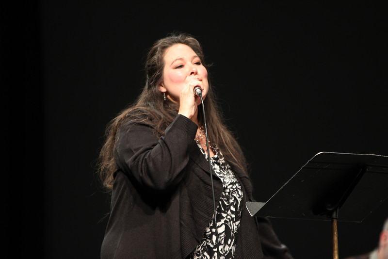 Karin Keller sings a Christmas song during the Mallets and Ivory concert Dec. 13. In addition to Keller's singing, the concert featured holiday music by CSC's ensembles for percussion, keyboard and guitar. (Photo by Justin Haag)