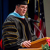 Dr. Randy Rhine delivers the commencement welcome for the Chadron State College graduates receiving a master's degrees Dec. 13. (Photo by Tiffany Valandra)