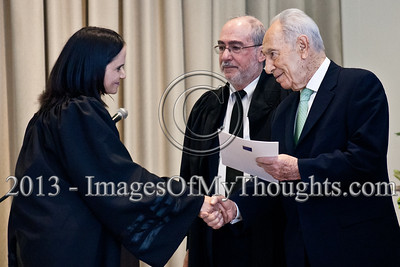 President of the State of Israel, Shimon Peres, shakes the hand of Advocate Avigail Zecharia and hands her a letter of appointment as a Magistrate Court judge in the Haifa District. Jerusalem, Israel. 14-Jan-2013.  President Shimon Peres grants letters of appointment to twelve new judges at the Presidents' Residence in the presence of Justice Minister Ya'akov Ne'eman and the Honorable Asher Grunis, President of the Supreme Court and High Court of Justice.