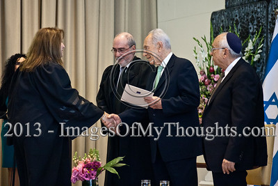 President of the State of Israel, Shimon Peres, shakes the hand of Advocate Rakefet Segal Mohar and hands her a letter of appointment as a Magistrate Court judge in the Haifa District. Jerusalem, Israel. 14-Jan-2013.  President Shimon Peres grants letters of appointment to twelve new judges at the Presidents' Residence in the presence of Justice Minister Ya'akov Ne'eman and the Honorable Asher Grunis, President of the Supreme Court and High Court of Justice.