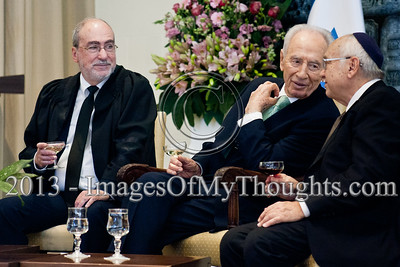 President Shimon Peres (center) exchanges small talk with Justice Minister Yaakov Neeman (right) and Supreme Court and High Court of Justice President Asher Grunis (left) at a ceremony in the President's Residence. Jerusalem, Israel. 14-Jan-2013.  President Shimon Peres grants letters of appointment to twelve new judges at the Presidents' Residence in the presence of Justice Minister Ya'akov Ne'eman and the Honorable Asher Grunis, President of the Supreme Court and High Court of Justice.