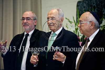 President Shimon Peres (center), Justice Minister Yaakov Neeman (right) and Supreme Court and High Court of Justice President Asher Grunis (left) toast the success of newly appointed judges at a ceremony in the President's Residence. Jerusalem, Israel. 14-Jan-2013.  President Shimon Peres grants letters of appointment to twelve new judges at the Presidents' Residence in the presence of Justice Minister Ya'akov Ne'eman and the Honorable Asher Grunis, President of the Supreme Court and High Court of Justice.