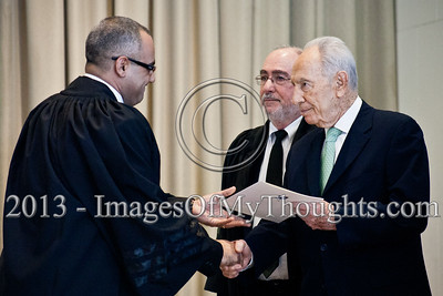 President of the State of Israel, Shimon Peres, shakes the hand of Advocate Mohamed Ali and hands him a letter of appointment as a Magistrate Court judge in the Haifa District. Jerusalem, Israel. 14-Jan-2013.  President Shimon Peres grants letters of appointment to twelve new judges at the Presidents' Residence in the presence of Justice Minister Ya'akov Ne'eman and the Honorable Asher Grunis, President of the Supreme Court and High Court of Justice.