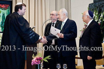 President of the State of Israel, Shimon Peres, shakes the hand of Advocate Shmuel Herbst and hands him a letter of appointment as a Magistrate Court judge in the Jerusalem District. Jerusalem, Israel. 14-Jan-2013.  President Shimon Peres grants letters of appointment to twelve new judges at the Presidents' Residence in the presence of Justice Minister Ya'akov Ne'eman and the Honorable Asher Grunis, President of the Supreme Court and High Court of Justice.