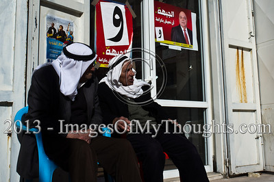 "Two men wearing traditional Arab kaffiyahs on their heads sit outside the offices of the Hadash Party, the Democratic Front for Peace and Equality. Um El-Fahm, Israel. 15-Jan-2013.   MK Afou Eghbariyeh of the Hadash Party, the Democratic Front for Peace and Equality, running for reelection for his second term in the Knesset, briefs the press one week ahead of Israeli national elections. Um El-Fahm, Israel. 15-Jan-2013.  Arab-Israelis make up about 20 percent of Israel's population. Some 800,000 have the right to vote in the upcoming Knesset elections (January 22nd); with voter turnout declining across all sectors of Israel society, some analysts are expecting a drop in participation among Muslim, Christian and other Arab-Israeli citizens (or ""Palestinians in Israel"" as some call themselves today).     Professor Asa'd Ghanem reported in a recent press briefing, one third of Arabs who participated in a recent Haifa University poll described themselves as apathetic and rarely voting in national elections while another third said they don't vote at all.  This election season has already been marked by rancorous debate among Arab leaders in Israel, and a general dissatisfaction expressed by Arab citizens with their communal leaders."