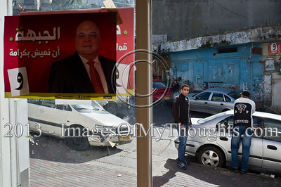 "A poster depicting MK Afou Eghbariyeh of the Hadash Party is pasted on the front window of the party's office. Um El-Fahm, Israel. 15-Jan-2013.   MK Afou Eghbariyeh of the Hadash Party, the Democratic Front for Peace and Equality, running for reelection for his second term in the Knesset, briefs the press one week ahead of Israeli national elections. Um El-Fahm, Israel. 15-Jan-2013.  Arab-Israelis make up about 20 percent of Israel's population. Some 800,000 have the right to vote in the upcoming Knesset elections (January 22nd); with voter turnout declining across all sectors of Israel society, some analysts are expecting a drop in participation among Muslim, Christian and other Arab-Israeli citizens (or ""Palestinians in Israel"" as some call themselves today).     Professor Asa'd Ghanem reported in a recent press briefing, one third of Arabs who participated in a recent Haifa University poll described themselves as apathetic and rarely voting in national elections while another third said they don't vote at all.  This election season has already been marked by rancorous debate among Arab leaders in Israel, and a general dissatisfaction expressed by Arab citizens with their communal leaders."