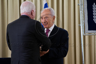 President Shimon Peres shakes the hand of Senator John McClain welcoming him and his Senate Delegation to Israel and the President's Residence. Jerusalem, Israel. 19-Jan-2013.  President Shimon Peres meets with US Senate delegation led by 2008 Republican candidate for Presidency, Sen. John McCain. Present are Senators Ayotte, Blumenthal, Whitehouse, Coons, senior adviser Brose and Ambassador Dan Shapira.