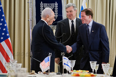 President Shimon Peres shakes hands and welcomes Senator Richard Blumenthal to Israel as Senator Sheldon Whitehouse looks on from behind, at the onset of a work meeting to discuss strengthening strategic relations between Israel and the US. Jerusalem, Israel. 19-Jan-2013.  President Shimon Peres meets with US Senate delegation led by 2008 Republican candidate for Presidency, Sen. John McCain. Present are Senators Ayotte, Blumenthal, Whitehouse, Coons, senior adviser Brose and Ambassador Dan Shapira.