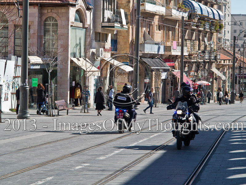 Jerusalem policemen on motorcycles patrol the city center along the tram line 24-hours ahead of Israel's national elections. Jerusalem, Israel. 21-Jan-2013.<br /> <br /> Israel Police is on alert ahead of elections to take place January 22. Twenty thousand officers, volunteers, security personal and ushers will be deployed on Election Day in 10,128 ballot locations securing the vote for 5,660,000 eligible voters.