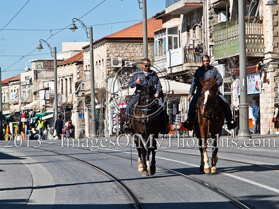 Jerusalem Police horsemen patrol the city center along the tram line 24-hours ahead of Israel's national elections. Jerusalem, Israel. 21-Jan-2013.  Israel Police is on alert ahead of elections to take place January 22. Twenty thousand officers, volunteers, security personal and ushers will be deployed on Election Day in 10,128 ballot locations securing the vote for 5,660,000 eligible voters.