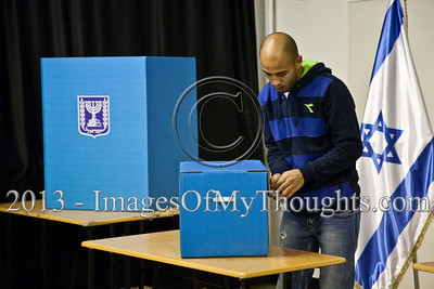 Members of a voting station committee prepare the ballot for voting in the 19th Knesset elections. Although voting stations are supposed to operate from 07:00 to 22:00, this voting station opened after a forty minute delay. Jerusalem, Israel. 22-Jan-2013.  The 19th Knesset elections are underway in Israel at 10,128 voting stations for 5,656,705 eligible voters. Reigning PM Netanyahu and the Likud Beteynu Party are expected to win the elections but with perhaps weakened political powers.