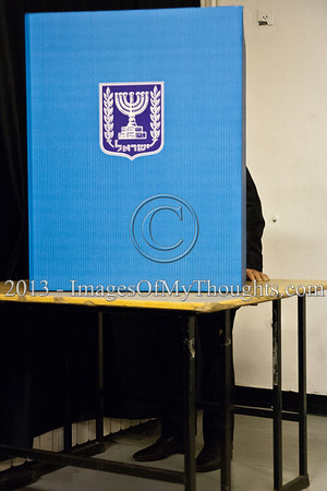 "President Shimon Peres stands behind a divider privately choosing a note representing his voting choice. When asked if he had doubts what note to choose the President answered ""I always weigh all the possibilities"". Jerusalem, Israel. 22-Jan-2013.  The 19th Knesset elections are underway in Israel at 10,128 voting stations for 5,656,705 eligible voters. Reigning PM Netanyahu and the Likud Beteynu Party are expected to win the elections but with perhaps weakened political powers."