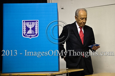 "President Shimon Peres walks out from behind a divider where he privately choosing a note representing his voting choice. When asked if he had doubts what note to choose the President answered ""I always weigh all the possibilities"". Jerusalem, Israel. 22-Jan-2013.  The 19th Knesset elections are underway in Israel at 10,128 voting stations for 5,656,705 eligible voters. Reigning PM Netanyahu and the Likud Beteynu Party are expected to win the elections but with perhaps weakened political powers."