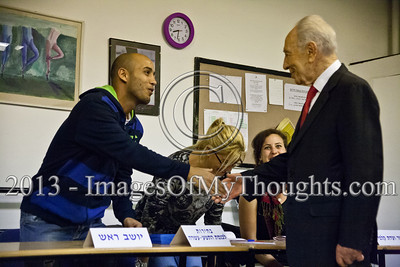 President Shimon Peres arrives at a voting station in Jerusalem to cast his vote for the 19th Knesset elections. Peres shakes hands with the voting station committee and is then identified with his national ID card before being allowed to vote. Jerusalem, Israel. 22-Jan-2013.  The 19th Knesset elections are underway in Israel at 10,128 voting stations for 5,656,705 eligible voters. Reigning PM Netanyahu and the Likud Beteynu Party are expected to win the elections but with perhaps weakened political powers.