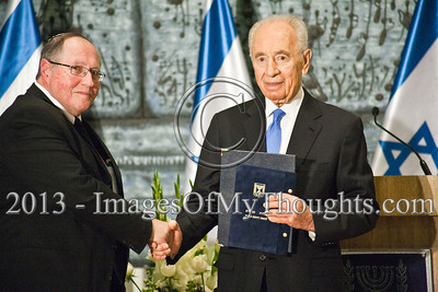 Supreme Court Judge Elyakim Rubinstein (L) hands President Shimon Peres (R) the official elections results following public remarks made by both and the two shake hands closing a ceremony in the President's Residence. Jerusalem, Israel. 30-Jan-2013.  President Peres receive official results of the Israeli elections for 19th Knesset from Judge Elyakim Rubinstein, Chair of Central Elections Committee. Peres to begin round of consultations before appointing the task of forming the coalition.