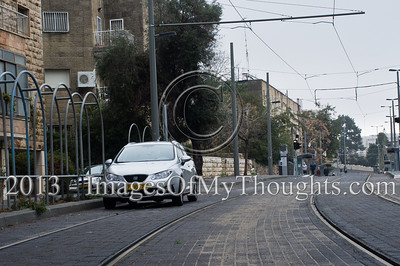 Cars are parked on the Jerusalem tram tracks and joggers take advantage of suspended public transportation on a Saturday morning. Jerusalem, Israel. 2-Feb-2013.   Norms formed during the British Mandate dictating a status quo in regard to observance of the Sabbath, later formulated in the 1951 legislation forbidding employment of Jews on the Sabbath, suspend public transportation almost nationwide.