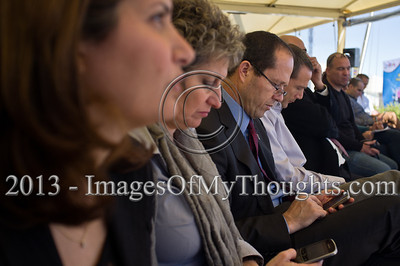 Jerusalem Mayor Nir Barkat (3rd from left) is busy using his iPhone at a press briefing on the March 1st planned Jerusalem International Marathon. Jerusalem, Israel. 4-Feb-2013.  Jerusalem Mayor Nir Barkat holds a press conference on the rooftop of the Mamilla Hotel, overlooking the Old City and many of the city's famous icons, on the upcoming 3rd Jerusalem International Marathon to take place March 1st.
