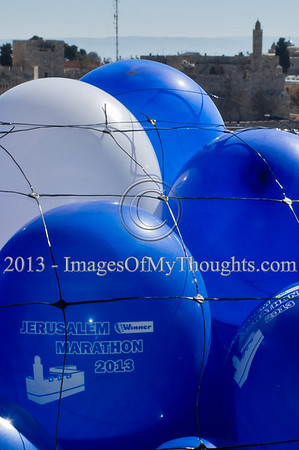 Helium filled balloons celebrating the 2013 Jerusalem International Marathon bear the King David Citadel icon as the tower itself is visible in the background. Jerusalem, Israel. 4-Feb-2013.  Jerusalem Mayor Nir Barkat holds a press conference on the rooftop of the Mamilla Hotel, overlooking the Old City and many of the city's famous icons, on the upcoming 3rd Jerusalem International Marathon to take place March 1st.