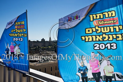 Banners celebrating the 2013 Jerusalem International Marathon frame the Dormition Abbey on Mount Zion in the background. Jerusalem, Israel. 4-Feb-2013.  Jerusalem Mayor Nir Barkat holds a press conference on the rooftop of the Mamilla Hotel, overlooking the Old City and many of the city's famous icons, on the upcoming 3rd Jerusalem International Marathon to take place March 1st.